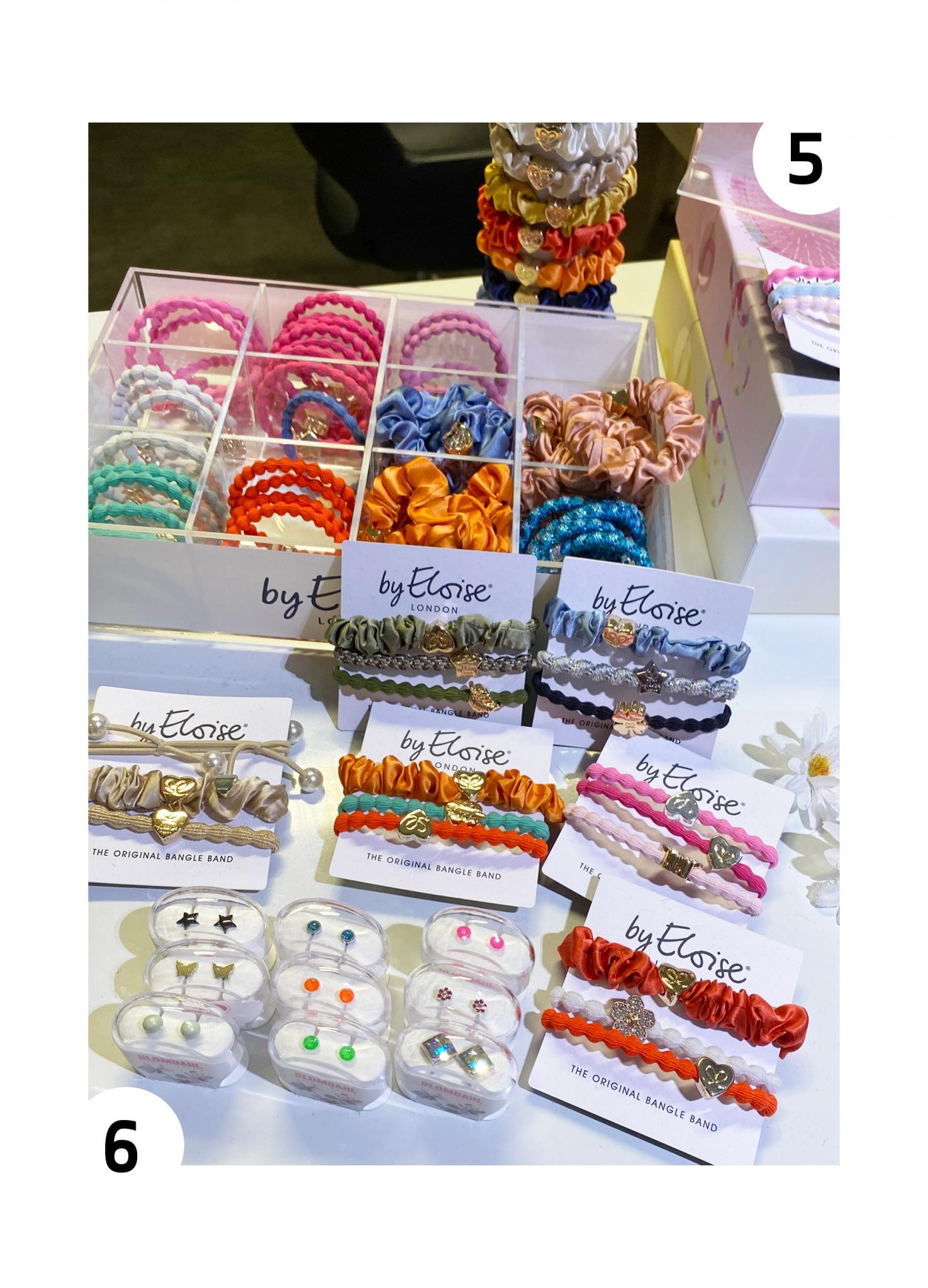 Assortert utvalg strikker i ulike farger fra By Eloise og øredobber i ulike farger fra Blomdahl